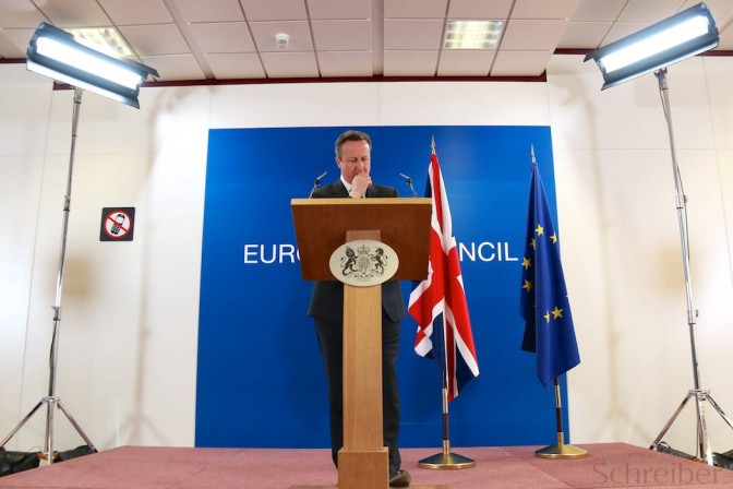 In european spotlight. Photo caption: The british Prime Minister David Cameron speaks at a news conference in Brussels, Friday, March 21, 2014. (Yann Schreiber / File)