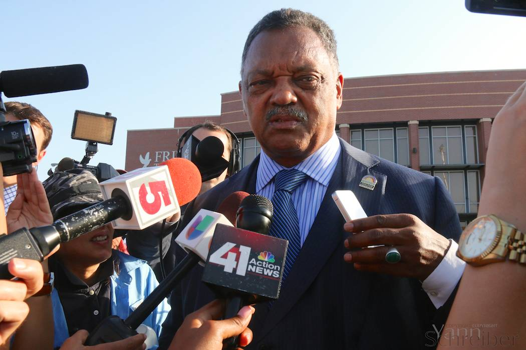 "Civil rights activist Jesse Jackson gives an interview before entering the Friendly Temple Missionary Baptist Church in St Louis, Missouri, on Monday, August 25, 2014, to attend the funeral service for Michael Brown. He says that ""everybody deserves equal protection before the law."" (Yann Schreiber)"