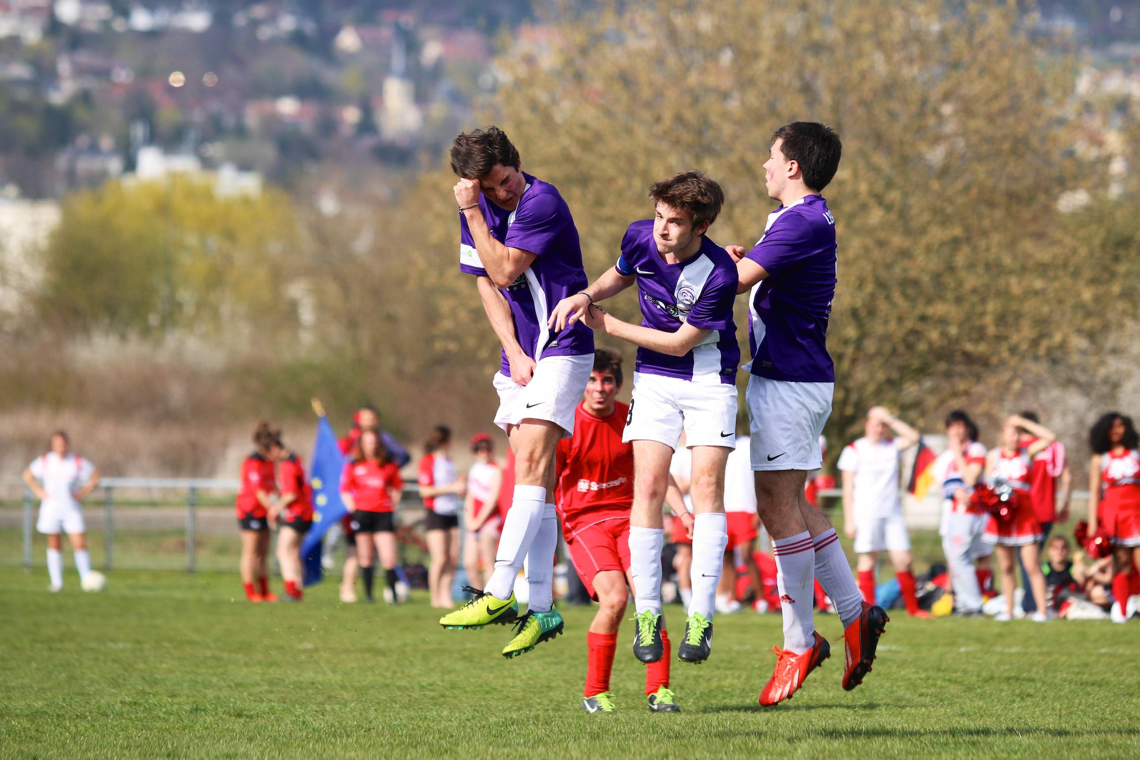 Players from Reims brace as a player from Nancy shoots during an inter-collegiate competition in Nancy, France, March 29, 2014.