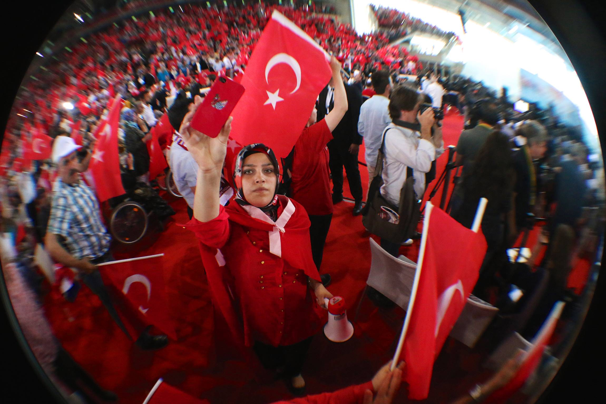 "A women takes a ""selfie"" at a rally of the turkish Prime Minister Recep Tayyip Erdoğan in Vienna, Austria, June 6, 2014."