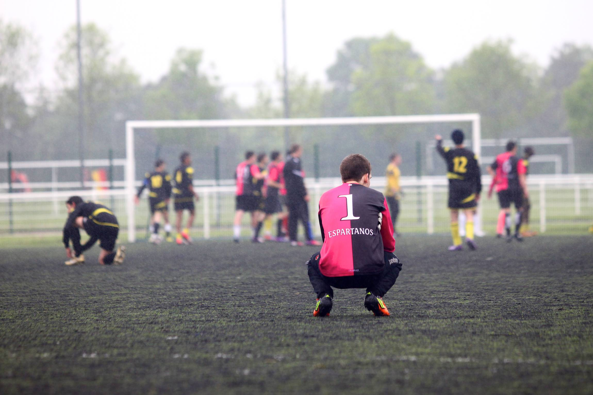 The goal keeper of Poitiers sits on the floor during a inter-collegiate competition in Reims, France, Mai 20, 2014.