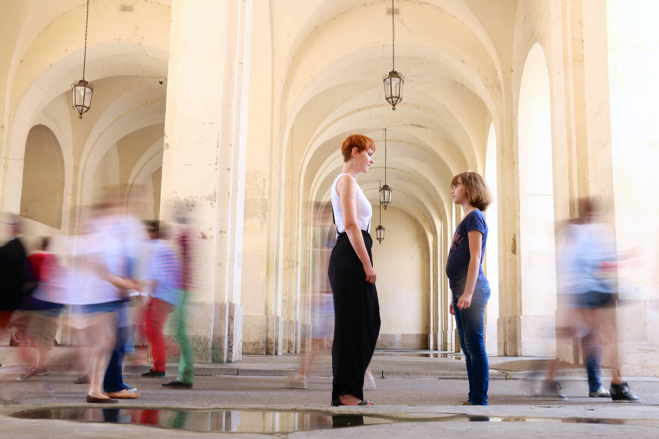 "Mother and daughter stand as people pass by in Nancy, France, Mai 18, 2014. This picture is part of a themed series that won the ""Collégiades 2014"" (Sciences Po) award in photography."