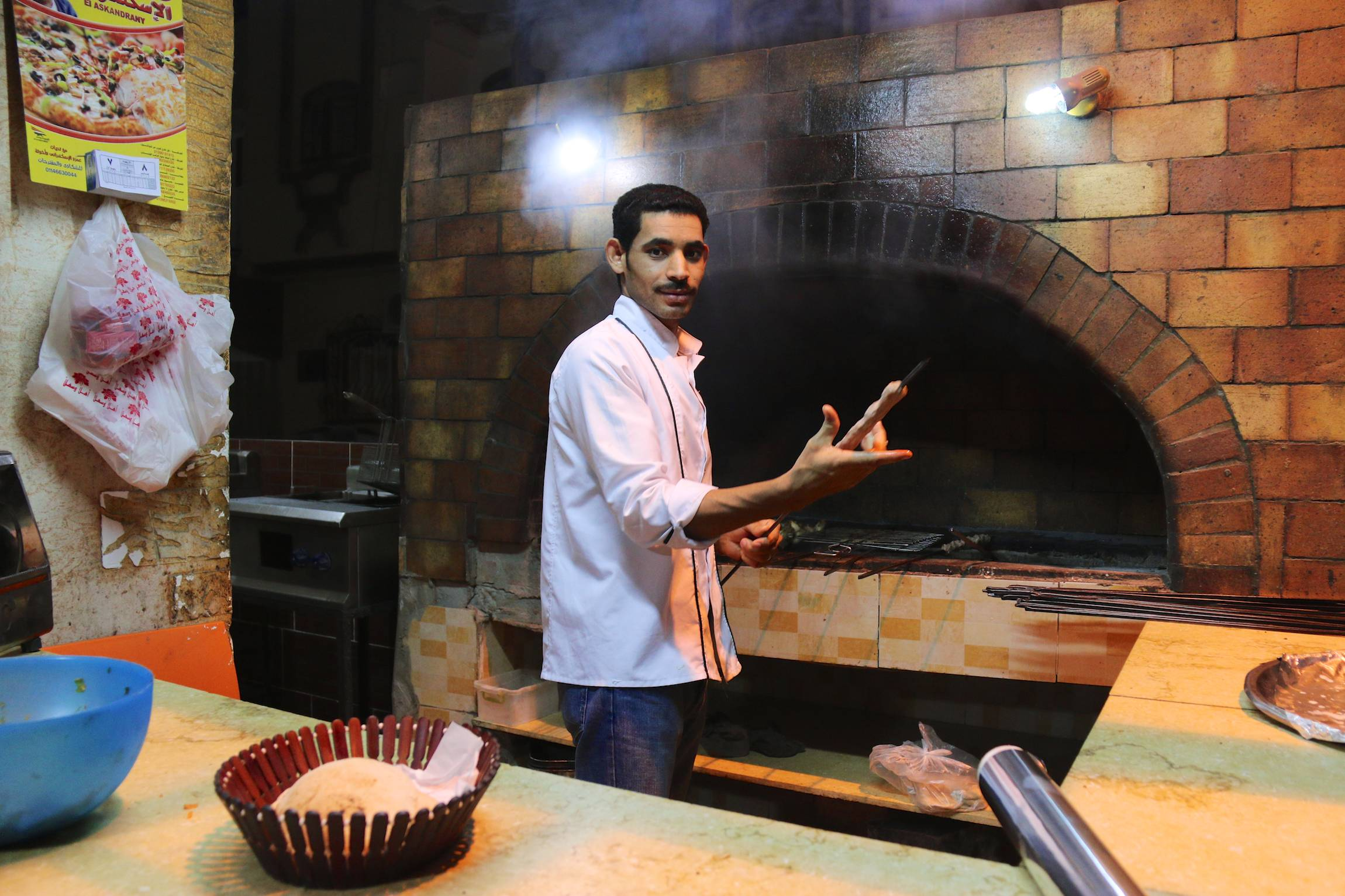 An Egyptian cook poses for a portrait as he prepares dinner for guests in El Quseir, Egypt, Jan. 8, 2014.