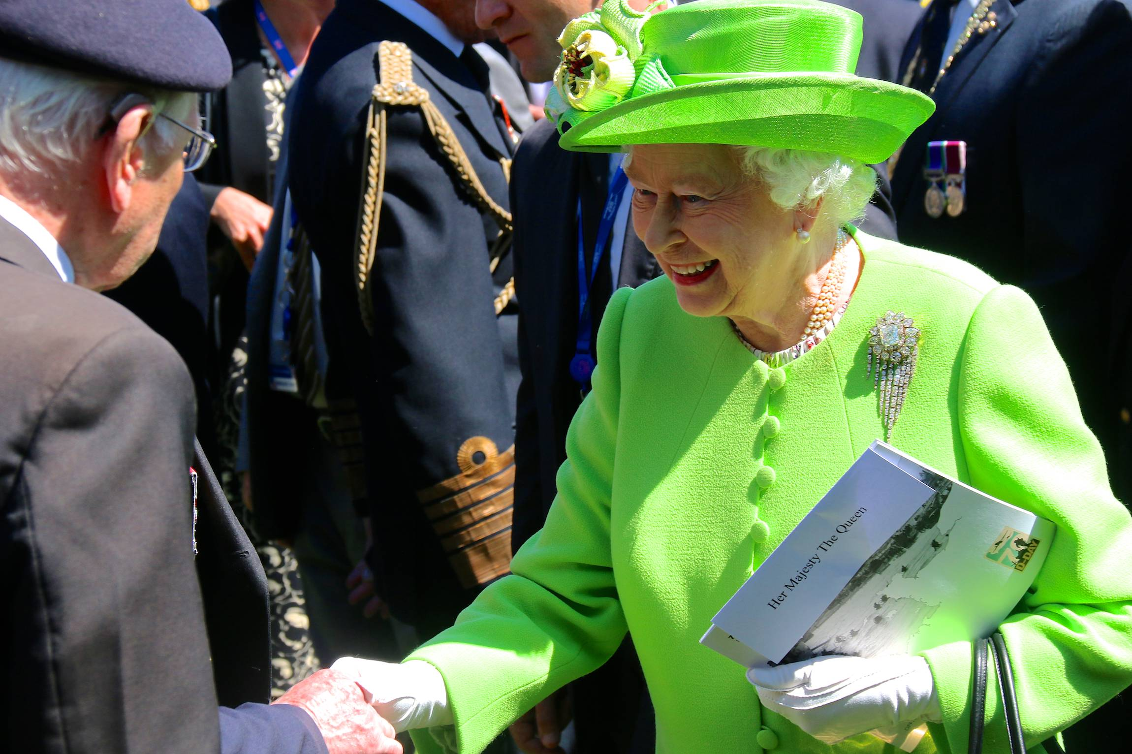 Her Majesty Queen Elisabeth II greets a veteran after the Franco-British Ceremony of the 70th anniversary of D-Day, on the Bayeux Cemetery in France, June 6, 2014.